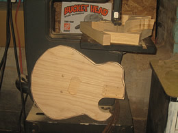 JX guitar body being cut